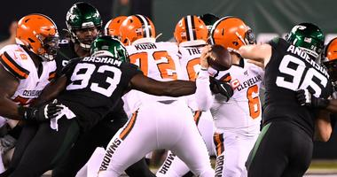 New York Jets linebacker Tarell Basham (93) gets to Cleveland Browns quarterback Baker Mayfield (6) in the first half at MetLife Stadium