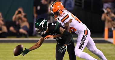 New York Jets wide receiver Robby Anderson (11) can not catch a pass while defended by Cleveland Browns cornerback Greedy Williams (26) in the first half at MetLife Stadium.