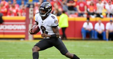 Baltimore Ravens quarterback Lamar Jackson (8) runs the ball during the first half against the Kansas City Chiefs at Arrowhead Stadium.