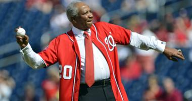 MLB former player and manger Frank Robinson throws out the first pitch before the game between Atlanta Braves and Washington Nationals at Nationals Park.