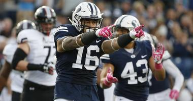 Brigham Young Cougars linebacker Sione Takitaki (16) reacts after making a tackle for no gain against the Cincinnati Bearcats in the first quarter at Lavell Edwards Stadium.