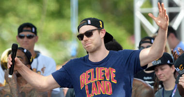 Jun 22, 2016; Cleveland, OH, USA; Cleveland Cavaliers guard Matthew Dellavedova greets the crowd during the Cleveland Cavaliers NBA championship celebration in downtown Cleveland. Mandatory Credit: Ken Blaze-USA TODAY Sports