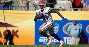Florida Gators wide receiver Antonio Callaway (81) runs with the ball against the Iowa Hawkeyes