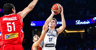 FILE - In this Sept. 17, 2017, file photo, Slovenia's Luka Doncic, right, shoots a basket as Serbia's Vasilje Micic tries to stop him during their Eurobasket European Basketball Championship final match in Istanbul.