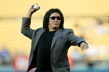 Rock musician Gene Simmons of the band KISS throws out the ceremonial first pitch before the game between the New York Mets and the Los Angeles Dodgers on July 5, 2011 at Dodger Stadium in Los Angeles, California.