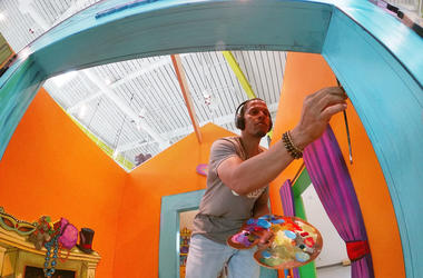 New Orleans Artist Terrance Osborne paints a play house at the Louisiana Children's Museum.