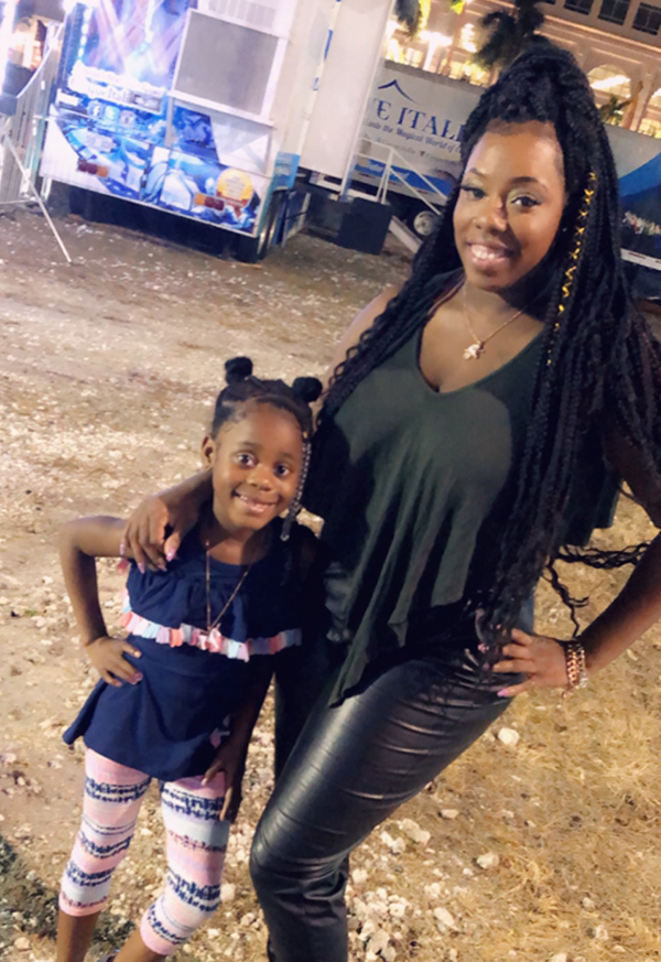 Latasha Brihm poses with the daughter she's taken in