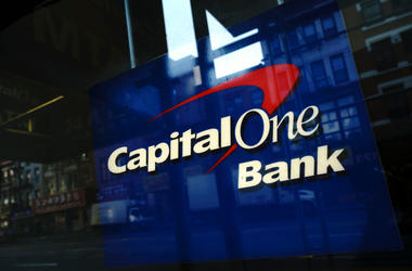 Capital One signage adorns a window of a Capital One bank in the Lower East Side of Manhattan on July 30, 2019 in New York City. In one of the largest-ever thefts of bank data, a software engineer in Seattle was arrested for hacking into a Capitol One ser