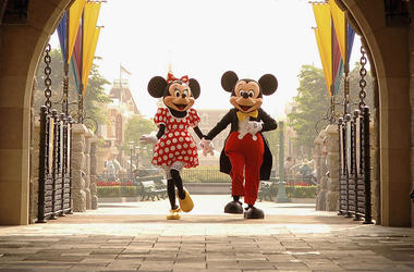 In this handout photo provided by Disney, Mickey and Minnie Mouse are seen walking through Sleeping Beauty Castle at the new Disneyland Park on September 1, 2005 in Hong Kong. The new theme park and vacation resort will officially open September 12.