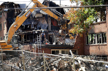 Federal, state and county investigators continue their 'brick-by-brick' inspection of the seciton of the Flower Branch Apartments that exploded and burned last week as they continue searching for one last victim August 16, 2016 in Silver Spring, Maryland.