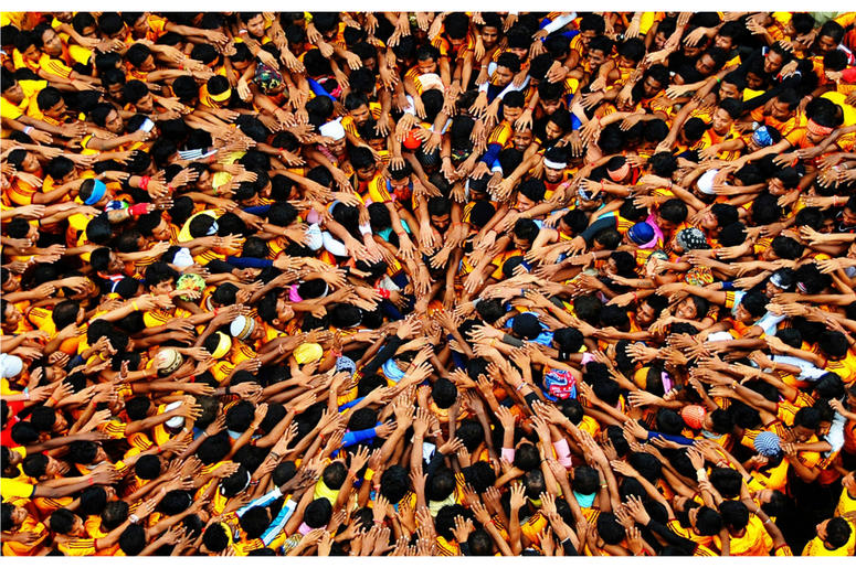 Govinda players gather together under Dahi Handi to make a human pyramid in order to catch and then break an earthen pot high in the air with the help of a rope, to win prizes.