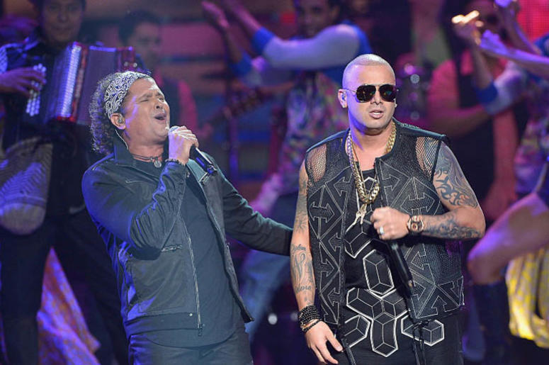 MIAMI, FL - APRIL 30: Carlos Vives (L) and Wisin perform onstage at the 2015 Billboard Latin Music Awards presented bu State Farm on Telemundo at Bank United Center on April 30, 2015 in Miami, Florida.