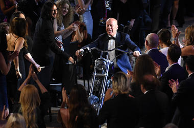"""LOS ANGELES - JULY 14: Bruce Willis enters on a motorcycle at the """"Comedy Central Roast of Bruce Willis"""" at the Hollywood Palladium on July 14, 2018 in Los Angeles, California."""