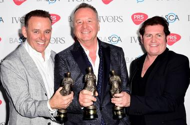 Mick MacNeil, Jim Kerr and Charlie Burchill of Simple Minds