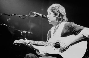 English singer-songwriter, multi-instrumentalist, and composer Paul McCartney performing with the Wings at Hammersmith Odeon, London, UK, 18th September 1975.