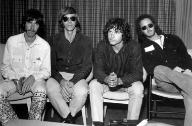 The Doors during a press conference at Heathrow Airport, London (left to right); drummer John Densmore, keyboard player Ray Mansarek, vocalist Jim Morrison (1943 - 1971) and guitarist Robby Krieger.
