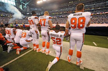 The Cleveland Browns team stand and kneel during the National Anthem