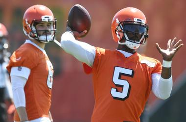 Cleveland Browns quarterback Baker Mayfield (6) watches as quarterback Tyrod Taylor (5) throws a pass during organized team activities at the Cleveland Browns training facility.
