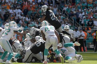 Oakland Raiders running back Marshawn Lynch (24) scores on a one-yard touchdown run in the third quarter against the Miami Dolphins at Hard Rock Stadium.