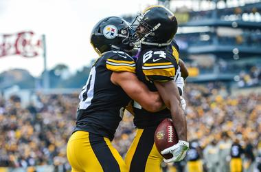 Pittsburgh Steelers wide receiver Antonio Brown (84) reacts with running back James Conner (30) after Brown scored a touchdown during the second quarter against the Cleveland Browns at Heinz Field.