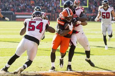 Cleveland Browns running back Nick Chubb (24) scores a touchdown between the defense of Atlanta Falcons linebacker Foye Oluokun (54) and outside linebacker De'Vondre Campbell (59) during the second quarter at FirstEnergy Stadium