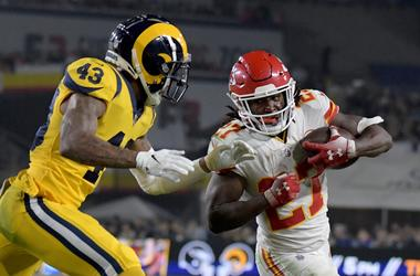Los Angeles Rams strong safety John Johnson (43) tackles Kansas City Chiefs running back Kareem Hunt (27) during the first half at the Los Angeles Memorial Coliseum.