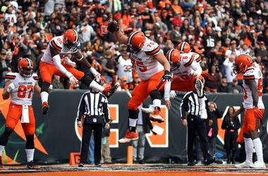 Browns offensive guard Joel Bitonio (75) spikes the ball to celebrate the touchdown by tight end David Njoku (85) against the Cincinnati Bengals.