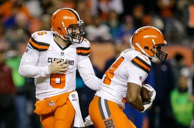 Cleveland Browns quarterback Baker Mayfield (6) hands the ball off to running back Nick Chubb (24) in the first quarter against the Denver Broncos at Broncos Stadium at Mile High.