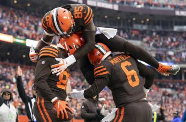 Cleveland Browns tight end Darren Fells (88) gets congratulated by quarterback Baker Mayfield (6) as tight end David Njoku (85) jumps on top of them during the second quarter against the Cincinnati Bengals at FirstEnergy Stadium.