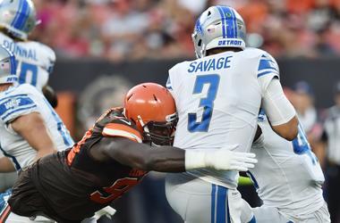 Cleveland Browns defensive tackle Devaroe Lawrence (99) sacks Detroit Lions quarterback Tom Savage (3) during the first quarter at FirstEnergy Stadium.