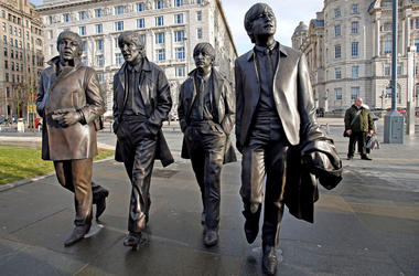 A new statue of the Beatles is unveiled by John Lennon's sister Julia Baird (not pictured) outside the Liverbuilding, in Liverpool.