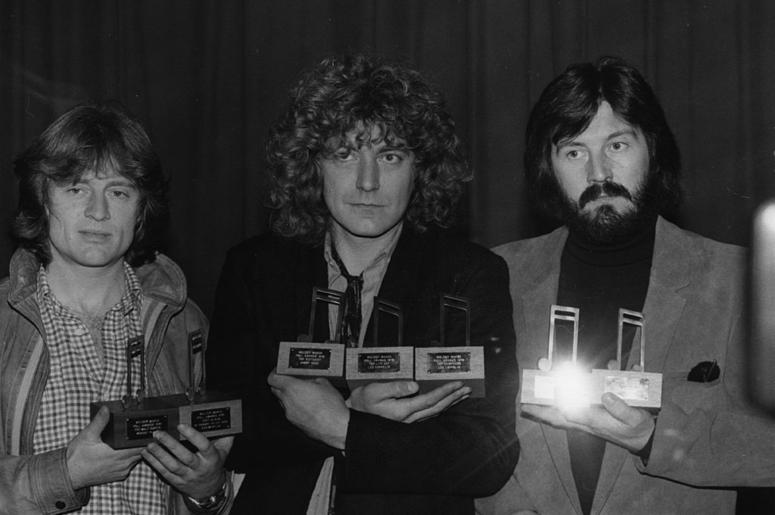 Led Zeppelin with their seven Melody Maker awards. They are, from left to right John Paul Jones (bass, keyboards), Robert Plant (vocals) and John Bonham (1947 - 1980) (drums)