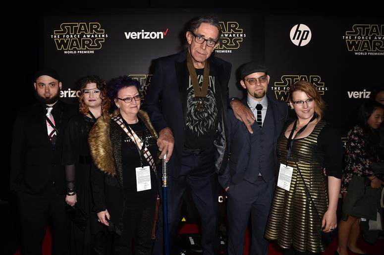 """Actor Peter Mayhew (C) and family attend the World Premiere of """"Star Wars: The Force Awakens"""""""
