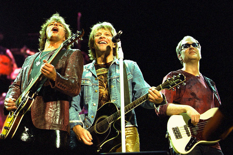 Left to right, Richie Sambora, Jon Bon Jovi and Hugh McDonald of the band Bon Jovi perform