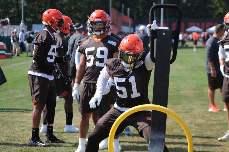 Browns rookie linebacker Mack Wilson works a sled during a drill at training camp