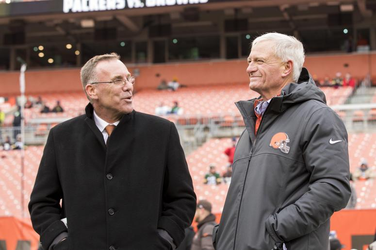 Cleveland Browns general manager John Dorsey, left, talks with team owner Jimmy Haslam during warmups before the game against the Green Bay Packers at FirstEnergy Stadium