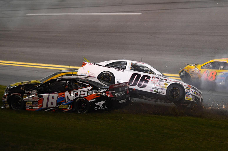ARCA Series drivers Chuck Hiers (06) and Riley Herbst (18) and Brad Smith (48) wreck during the Lucas Oil 200 at Daytona International Speedway.