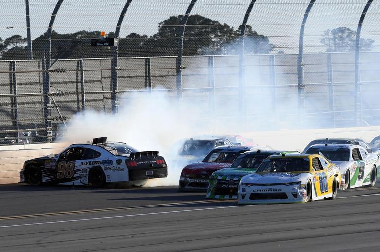 NASCAR Xfinity Series driver Aric Almirola (98) wrecks during the PowerShares QQQ 300 at Daytona International Speedway.