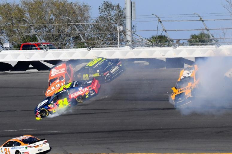 NASCAR Cup Series driver Daniel Suarez (19), Jimmie Johnson (48) , William Byron (24) and Erik Jones (20) wreck during the Daytona 500 at Daytona International Speedway.