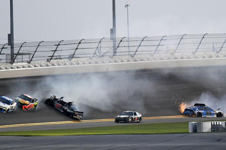 NASCAR Cup Series driver Matt DiBenedetto (32) and Alex Bowman (88) wreck during the Daytona 500 at Daytona International Speedway.