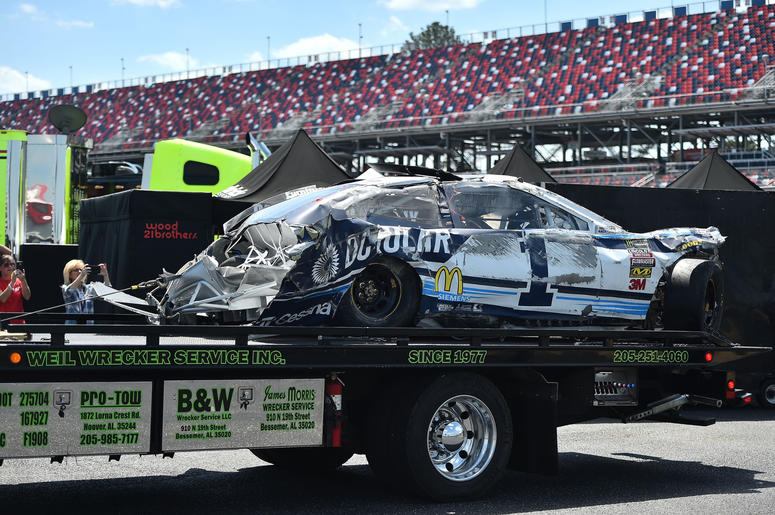 he wrecked car of NASCAR Cup Series driver Jamie Mcmurray (1) is brought to the garage during practice for the GIECO 500 at Talladega Superspeedway.