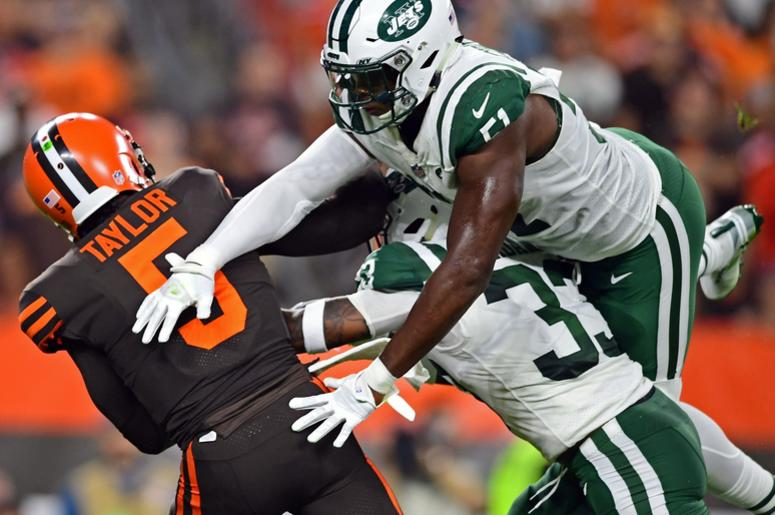 New York Jets linebacker Brandon Copeland (51) andNew York Jets defensive back Jamal Adams (33) hits Cleveland Browns quarterback Tyrod Taylor (5) during the first half of a game at FirstEnergy Stadium.