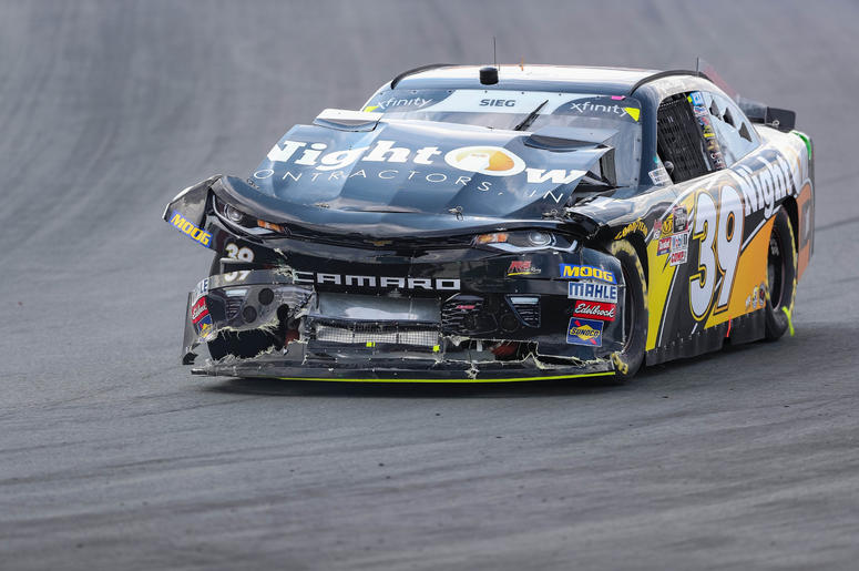 NASCAR Xfinity Series driver Ryan Sieg (39) tries to return to the pits after a wreck during the Drive for the Cure 200 at Charlotte Motor Speedway.