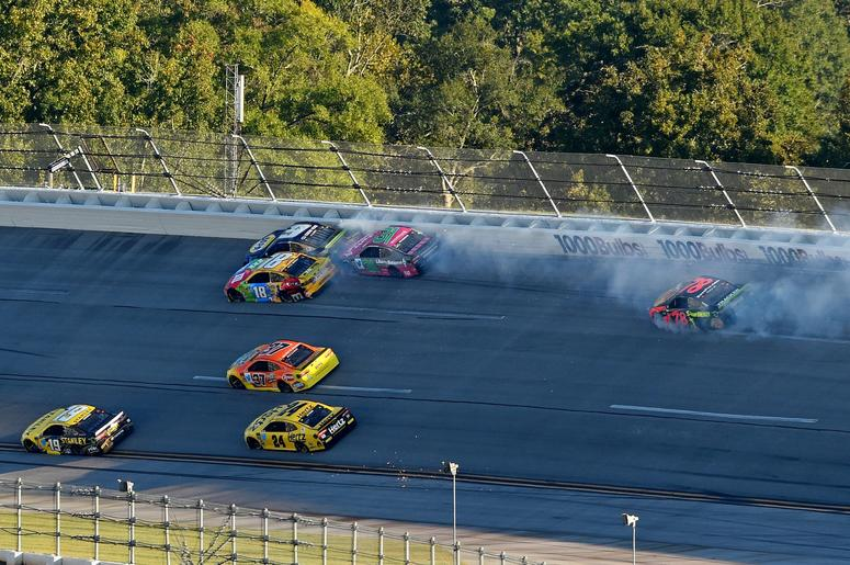 NASCAR Cup Series driver Kyle Busch (18) and NASCAR Cup Series driver Chase Elliott (9) wreck during the 1000Bulbs.com at Talladega Superspeedway.