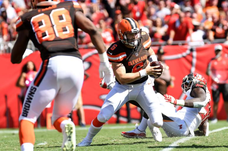 Cleveland Browns quarterback Baker Mayfield (6) scrambles in the first half against the Tampa Bay Buccaneers at Raymond James Stadium.