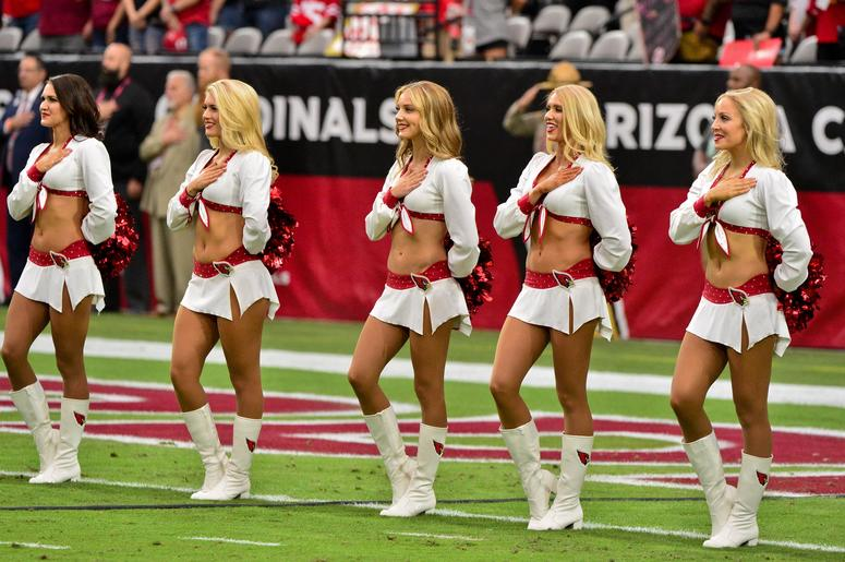 Arizona Cardinals cheerleaders look on during the National Anthem prior to the game against the San Francisco 49ers at State Farm Stadium.