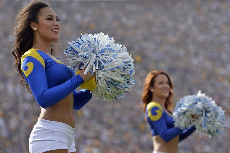 Los Angeles Rams cheerleaders look on during the second quarter against the Green Bay Packers at Los Angeles Memorial Coliseum.
