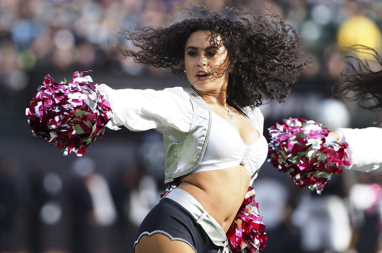 Oakland Raiders cheerleader performs during a timeout against the Indianapolis Colts during the fourth quarter at Oakland Coliseum.