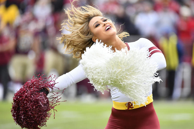 Washington Redskins cheerleader performs against the Houston Texans during the second half at FedEx Field.