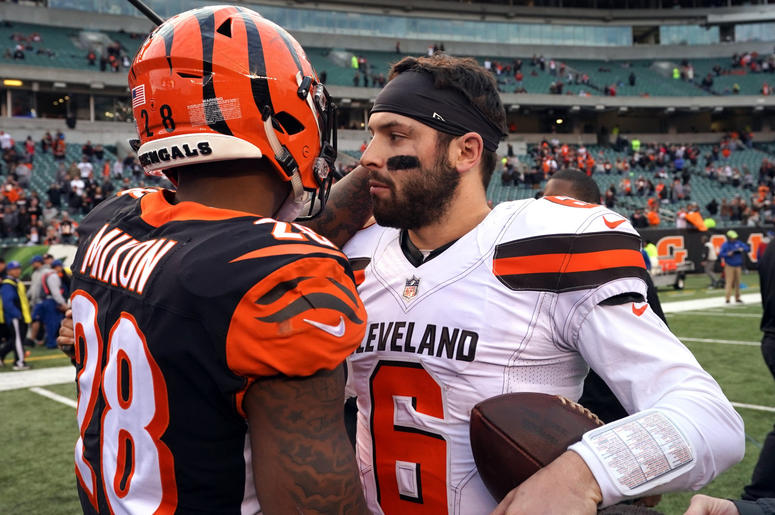 incinnati Bengals running back Joe Mixon (28) meets with Cleveland Browns quarterback Baker Mayfield (6) after their game at Paul Brown Stadium.